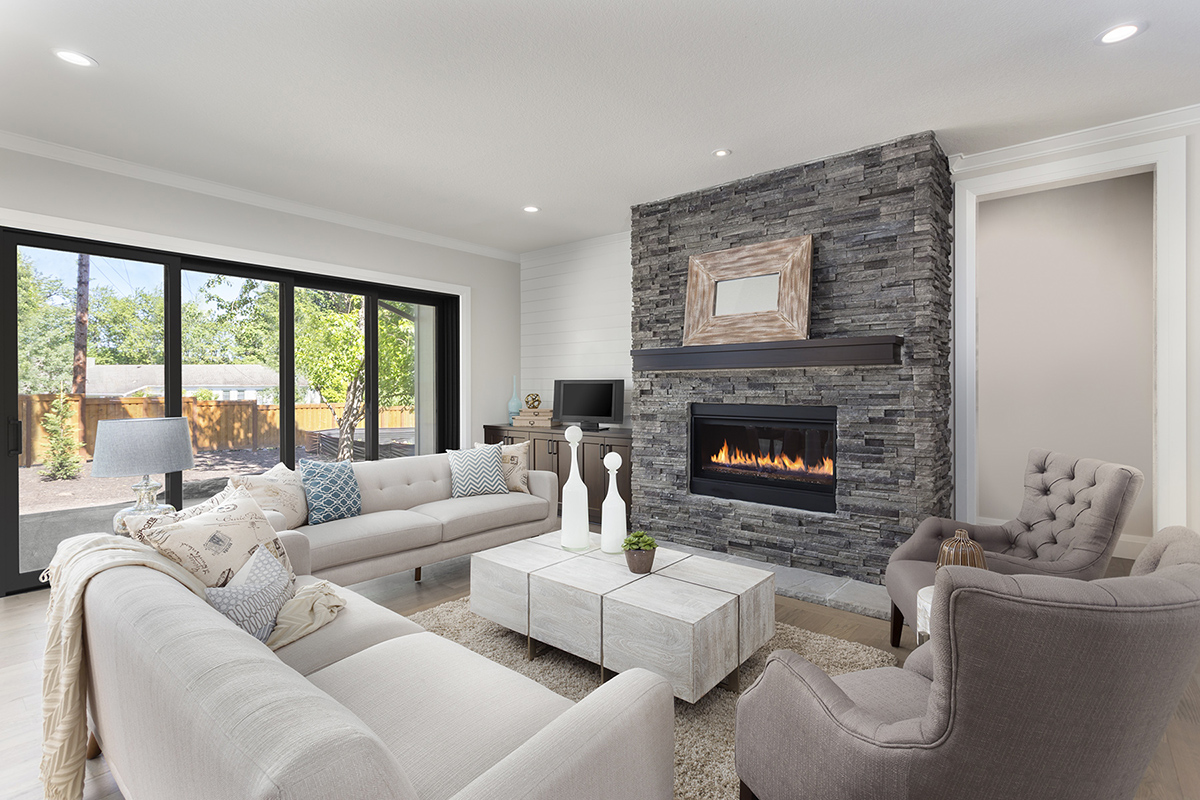 furnished living room in newly constructed luxury home